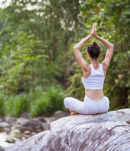Portrait yoga pose TRL rock sitting
